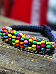 main bracelet bois coloré cordon
