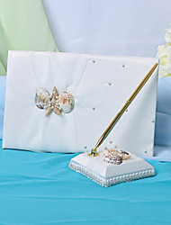 mariage livre d'or et un stylo serti de signe de coquillage dans le livre