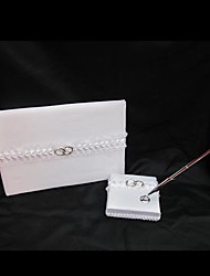 Wedding Guest Book and Pen Set In White Satin With Wedding Ring Accent Sign In Book