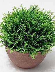 pino artificial con florero redondo