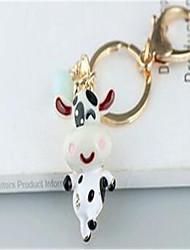 mignon petit porte-clés de voiture de la vache